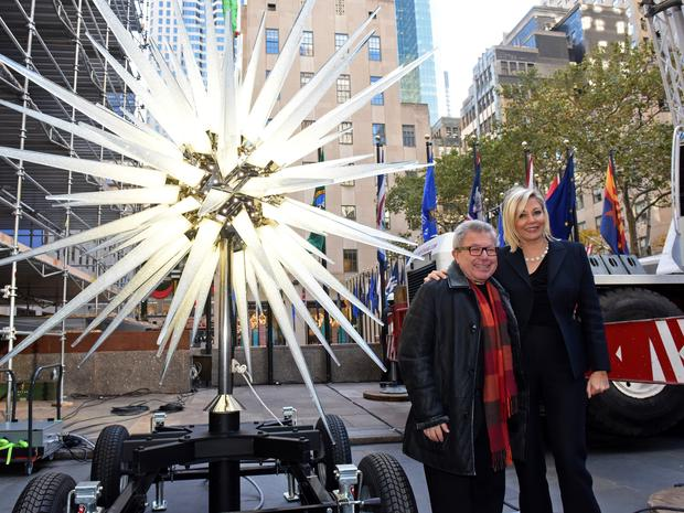 A close-up of Nadja Swarovski and Daniel Libeskind in front of Rockefeller Center's new Swarovski Christmas tree topper for 2018 made by Daniel Libeskind.