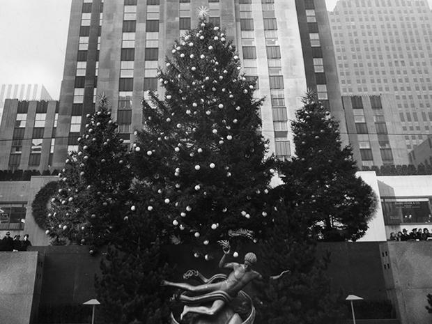 The Rockefeller Christmas tree, decorated with ornaments, with two smaller, decorated trees behind it, in 1942.