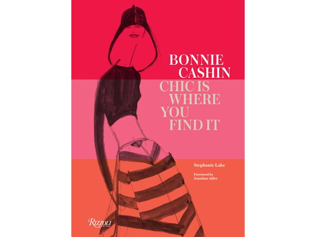 "Bonnie Cashin cover that reads ""Bonnie Cashin, Chic Where You Find It"", featuring a black sketch of a tall woman wearing a black long sleeve and a striped skirt with red, orange and pink background."