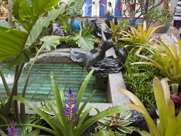 A view of the Channel Garden fish fountain from the side at Rockefeller Center.