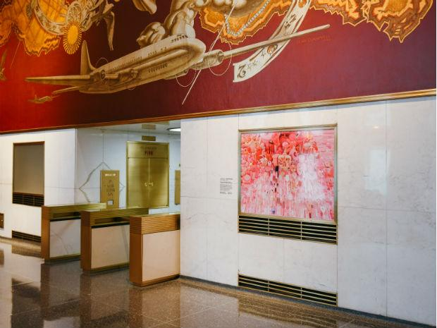 A pink portrait hangs in the lobby of Rockefeller Plaza, part of the Pink Projects.