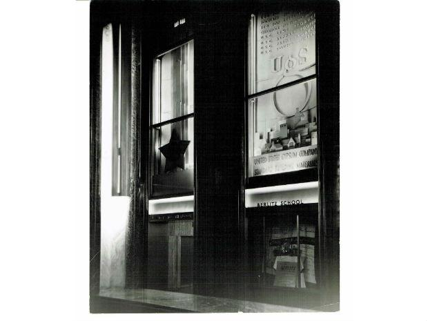 A black and white photo of early Rockefeller Center lobby commercial collateral.