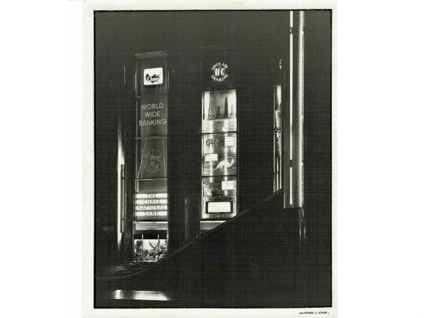 A black and white photo of early Rockefeller lobby, showing commercials for the Chase National Bank and Sinclair gasoline.
